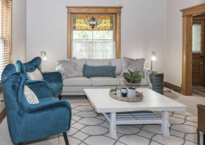 Living room with blue chairs